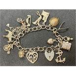 Vintage silver charm bracelet with lock and chain and 14 charms 49g