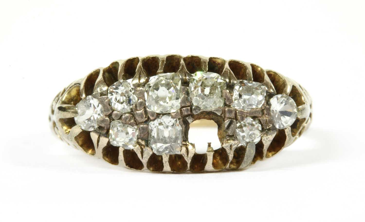 A gold boat shaped diamond ring,