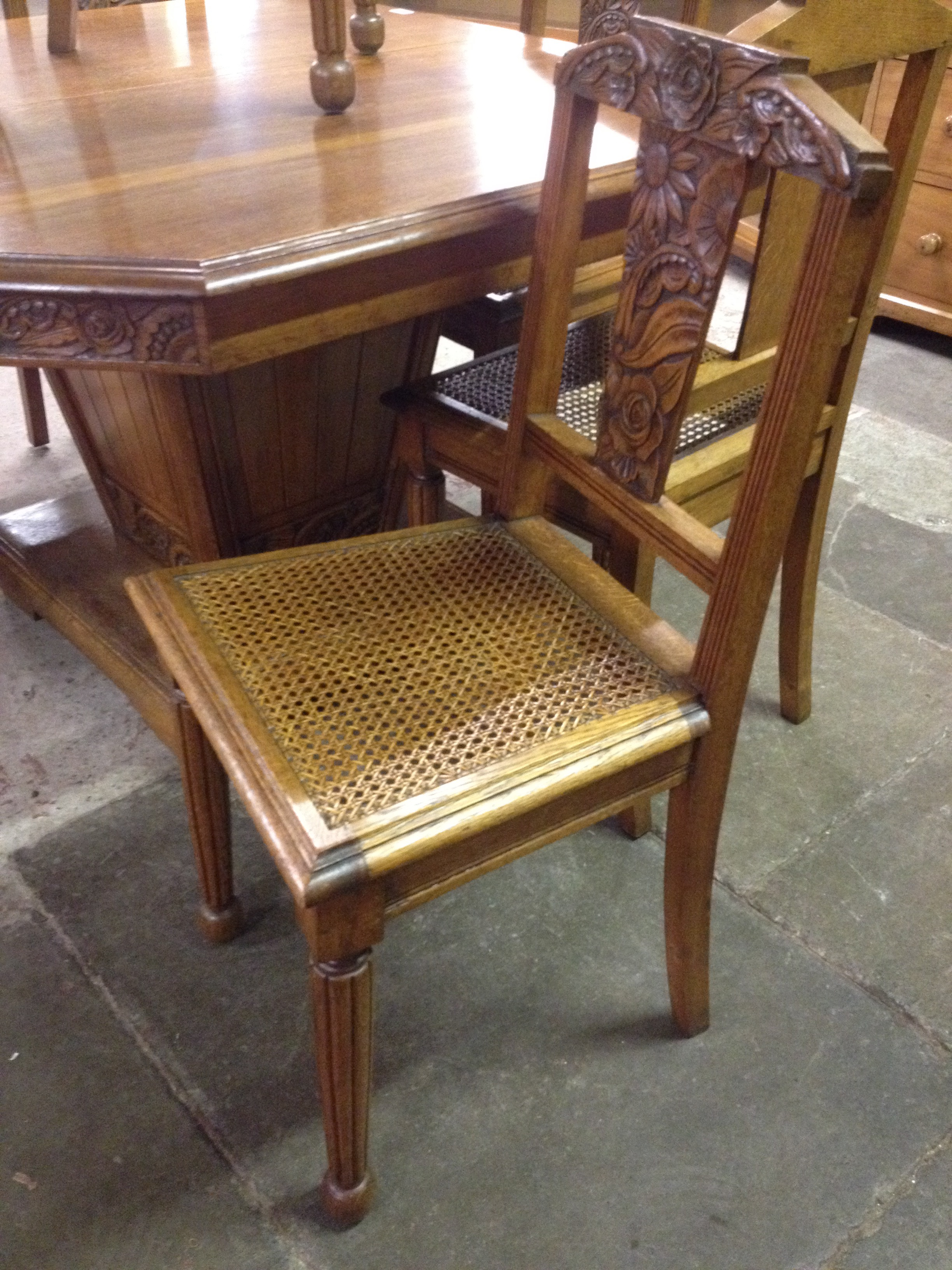 A french art deco oak extending pedestal dining table with for Table bergere