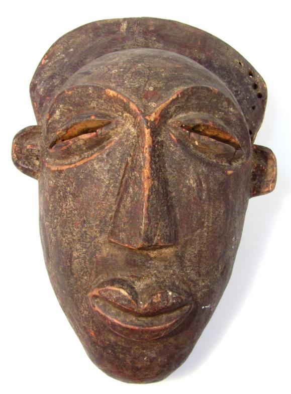 Lot 192 - An early 20thC death mask, with carved features in soft wood, 36cm high, possibly Cambodian.