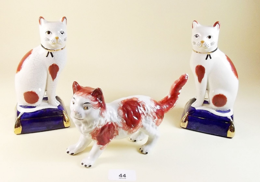 Lot 44 - A pair of reproduction Staffordshire cat ornaments