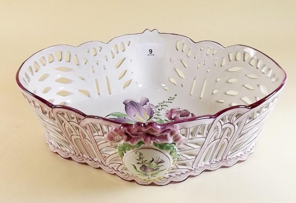 Lot 9 - A St Clement Luneville faience basket painted floral decoration circa 1870, 29 x 20cm