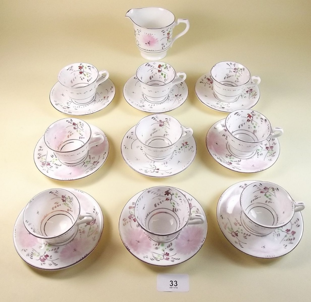 Lot 33 - A Victorian part pink lustre tea service comprising eight small cups and saucers and a milk jug
