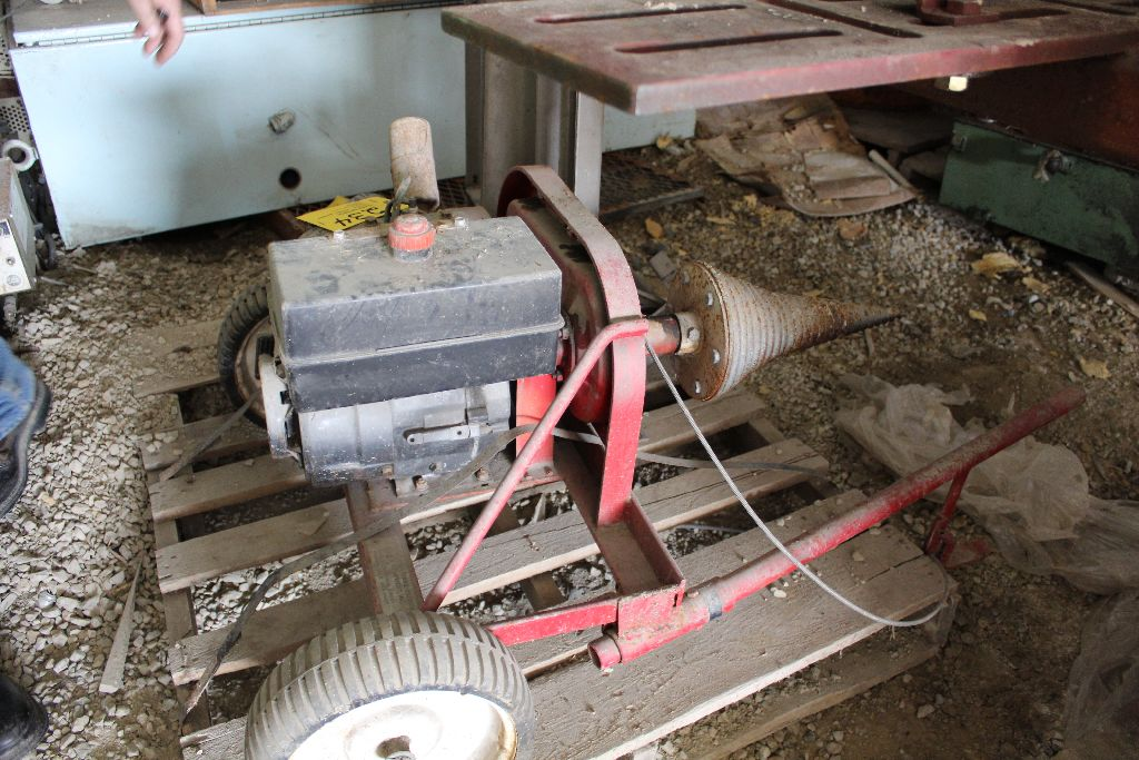 Gas power cork screw log splitter.