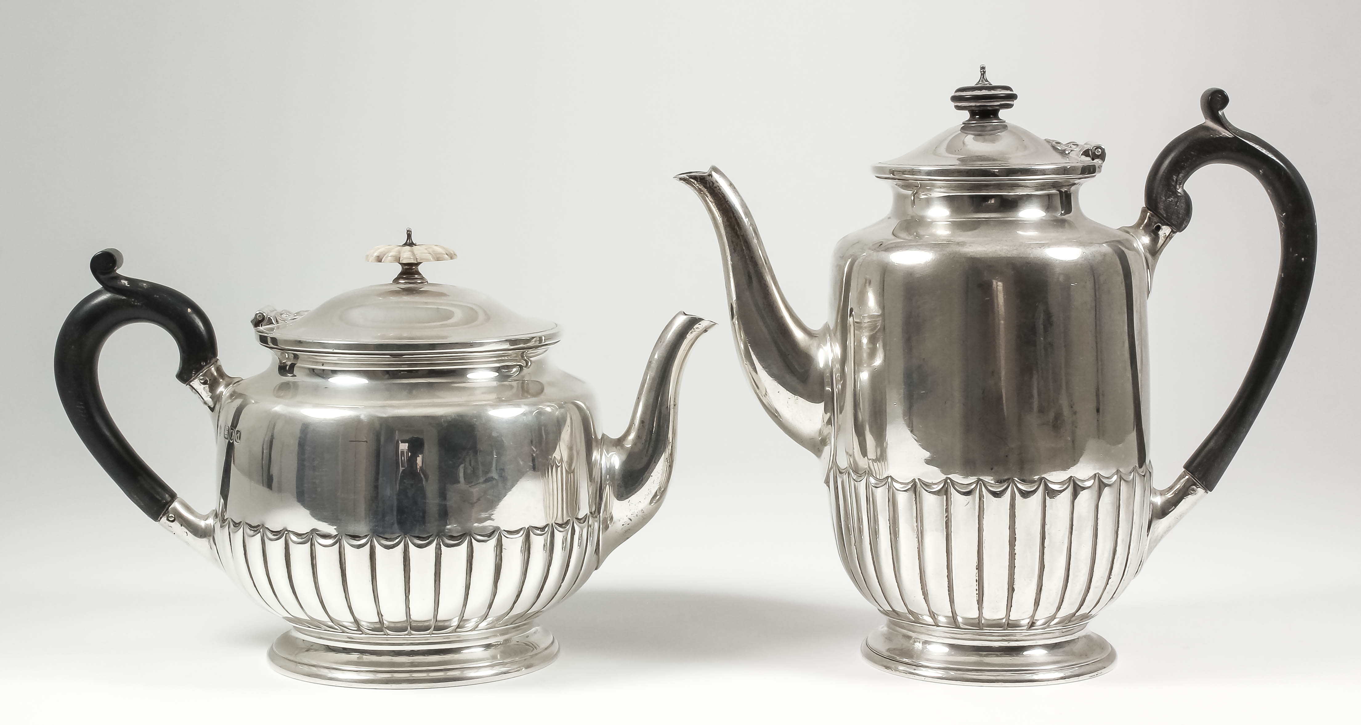 Lot 5 - A late Victorian silver cylindrical teapot and coffee pot with slightly domed covers, part reeded
