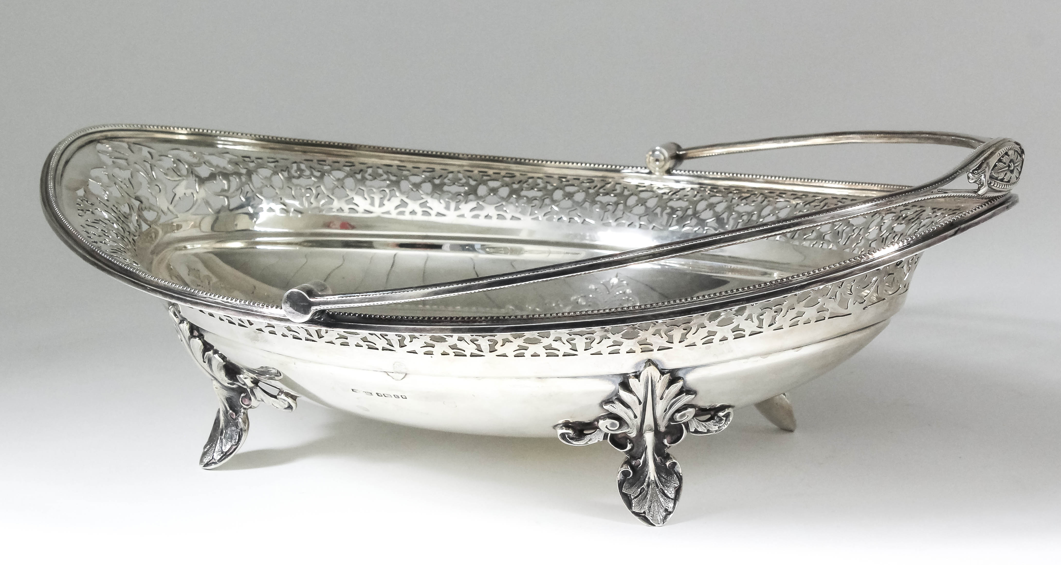 Lot 22 - A good Victorian silver ovoid cake basket, the pierced rim with engraved banding to centre and