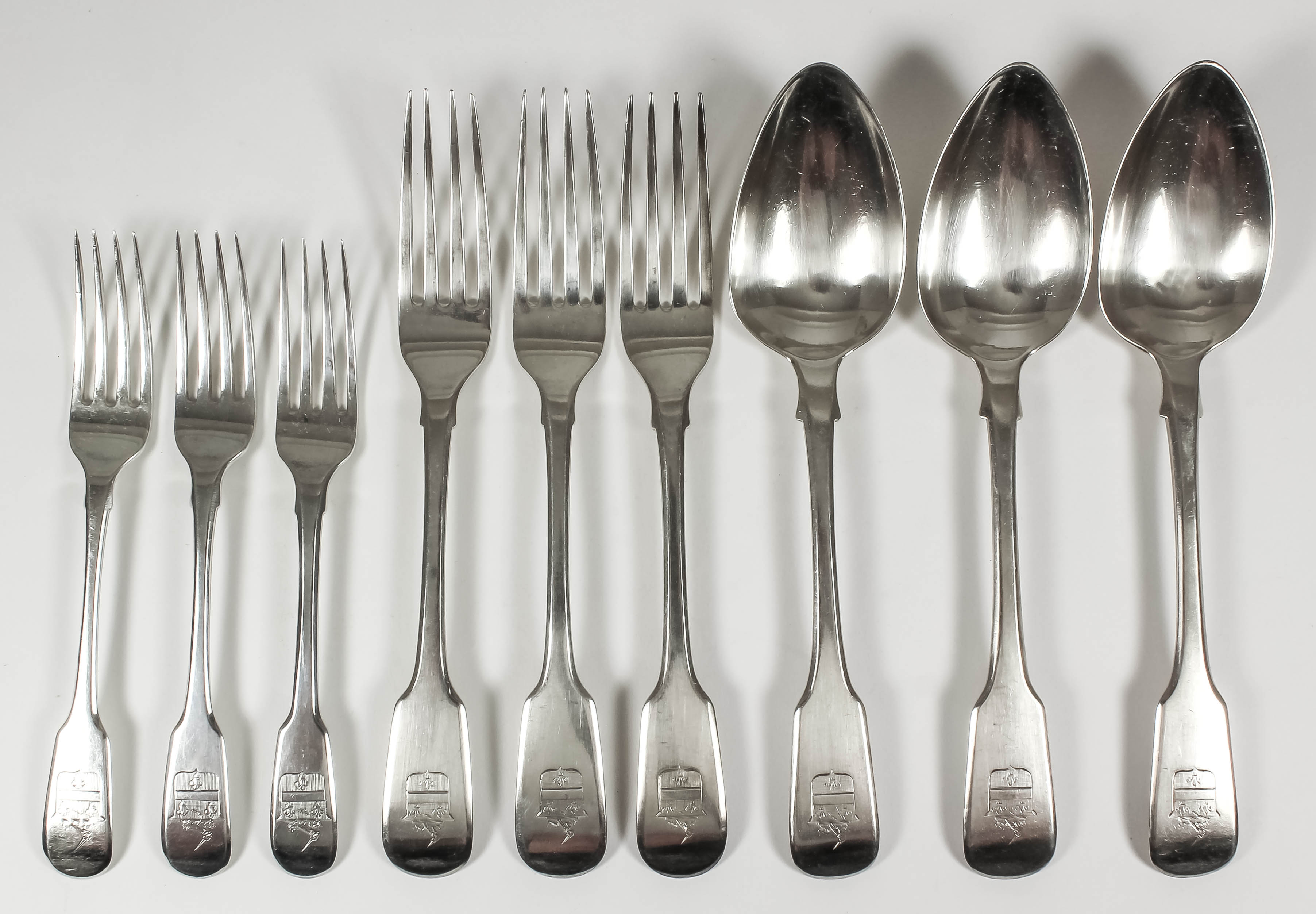 Lot 38 - A set of six George IV silver fiddle pattern table spoons and six matching table forks, by William