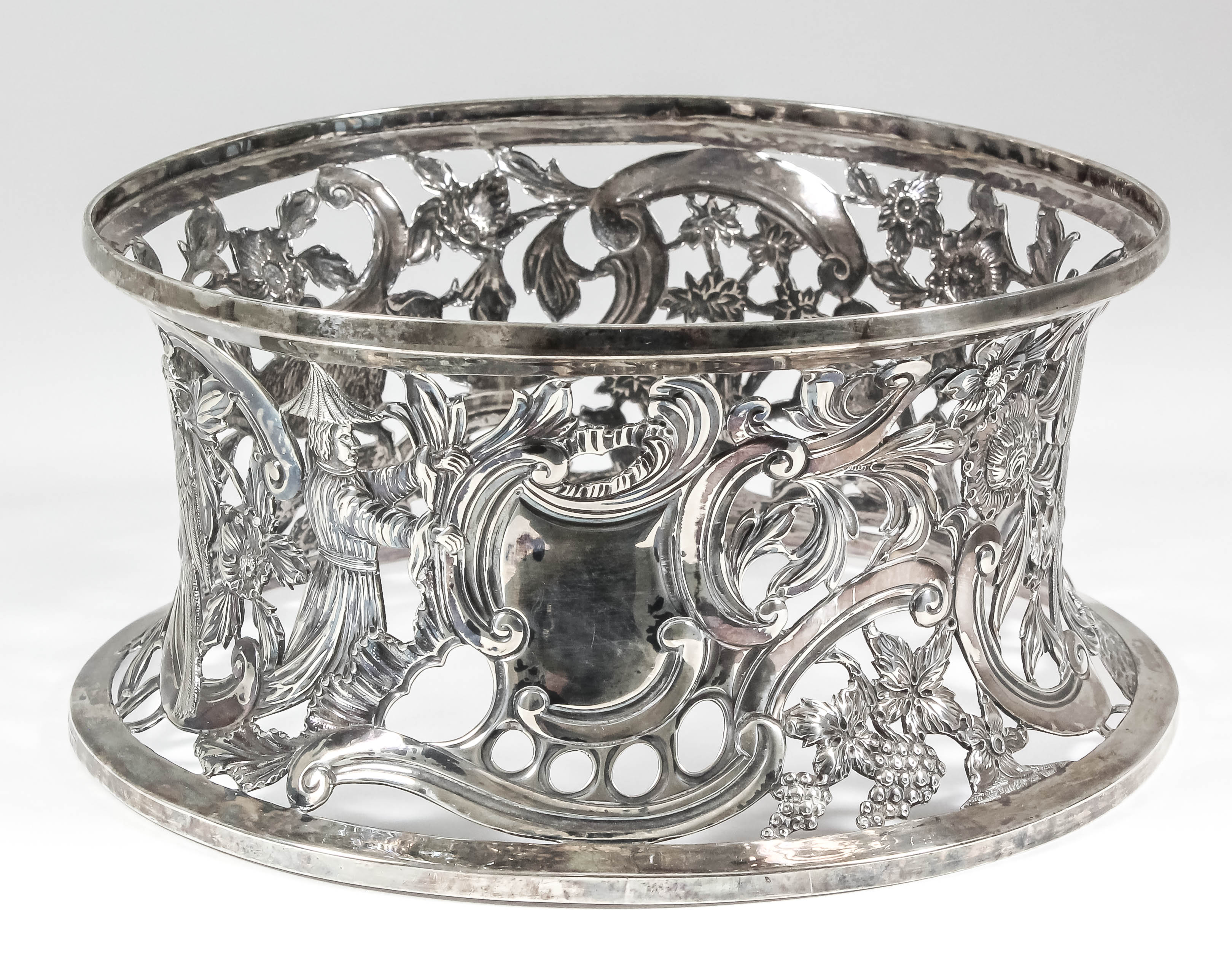 Lot 15 - An Edward VII Irish silver dish ring pierced and embossed with shaped cartouche, figures, animals,