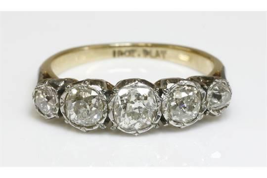 2e7418fd02e58 A graduated five stone diamond ring, with cushion cut and old ...