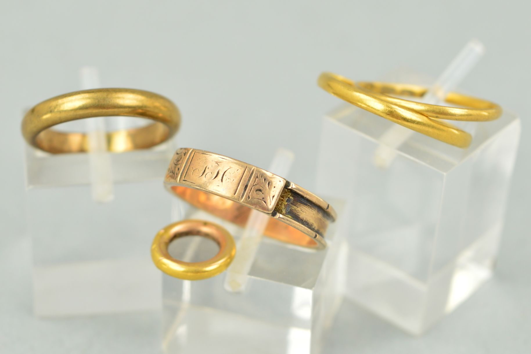 Lot 18 - FOUR RINGS AND A CLASP to include a Georgian gold memorial ring with personal engraving to inside of