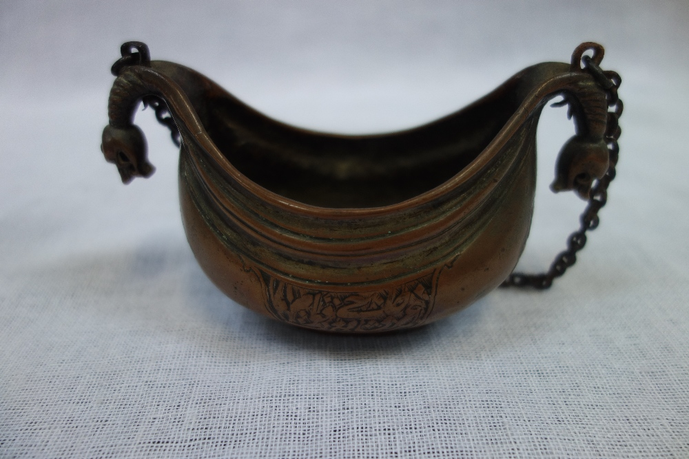Lot 313 - AN EASTERN COPPER HANGING CENSER, of boat form with beast head terminals and engraved