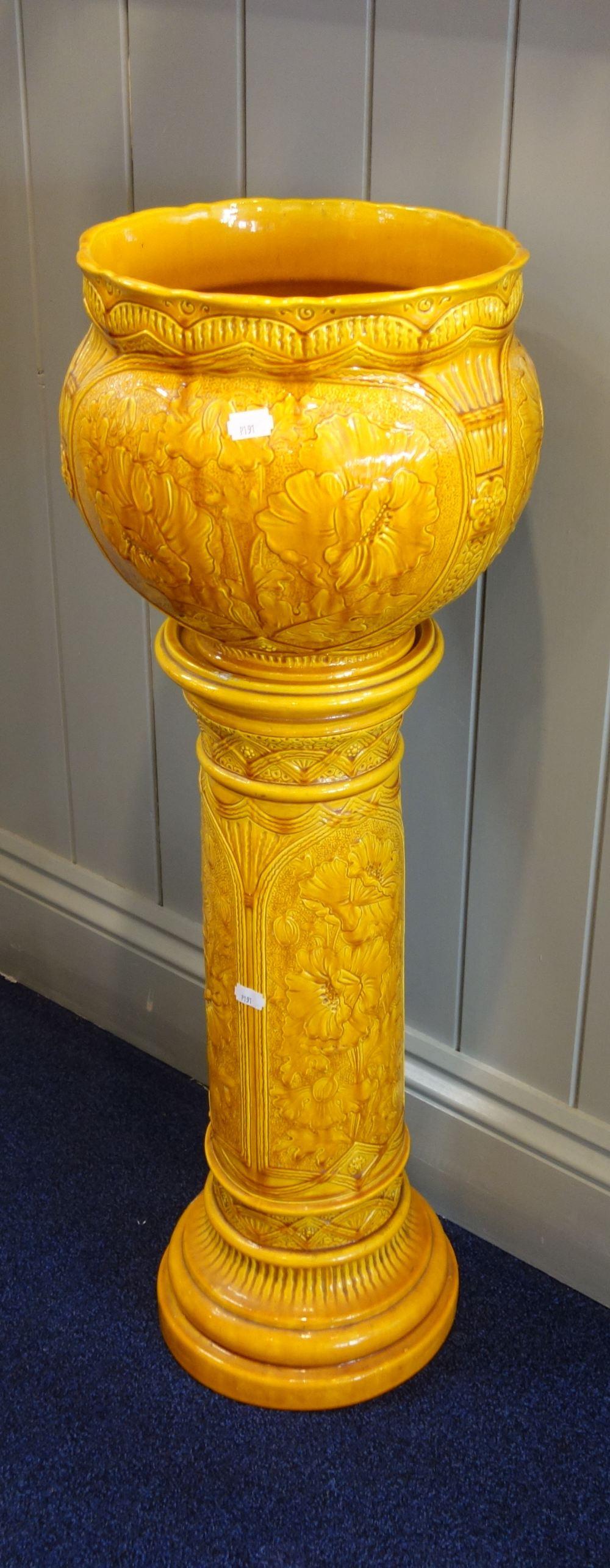 Lot 12 - A BURMANTOFT'S FAIENCE ORANGE GLAZED JARDINIERE ON STAND, 85cm high (overall)
