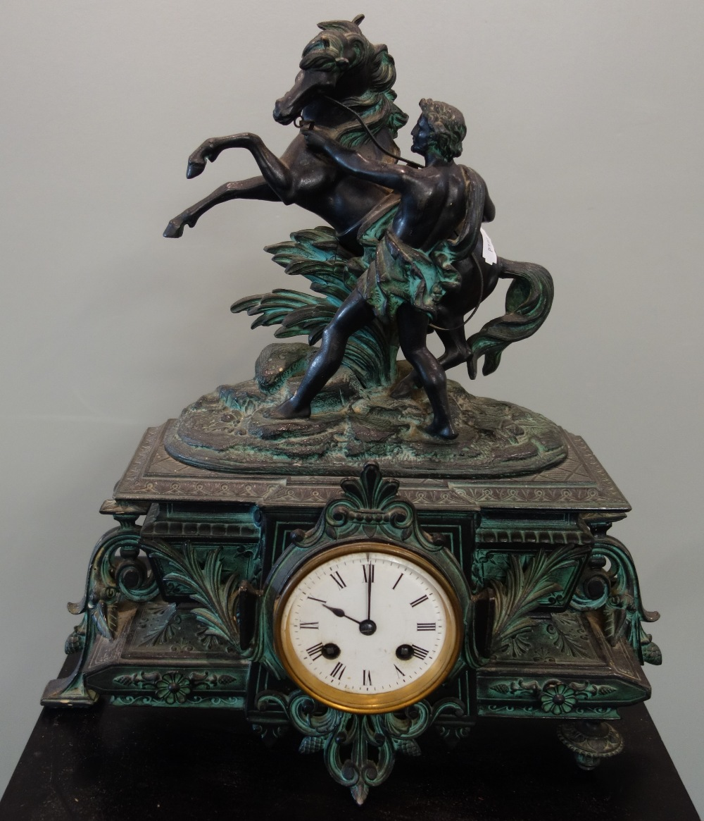 Lot 11 - A 19TH CENTURY SPELTER MANTEL CLOCK decorated with a study of a horse with a figure, 41cm high