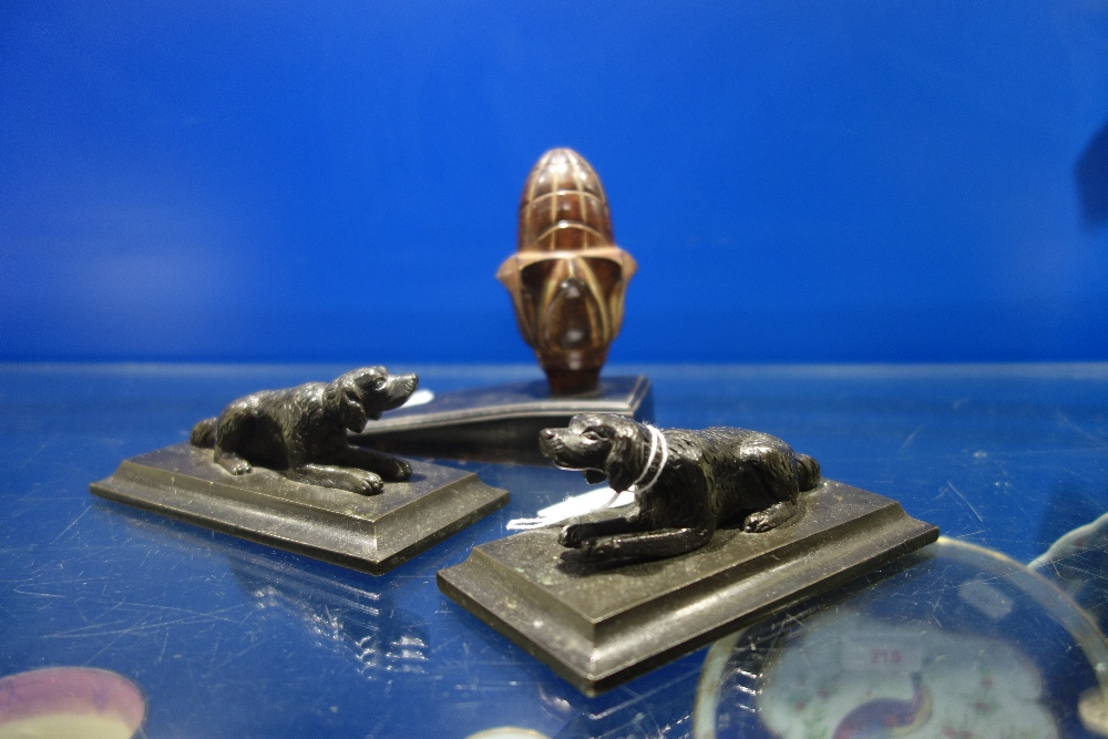 Lot 250 - A PAIR OF PATINATED BRONZE BOOKENDS with dogs and a doorstop