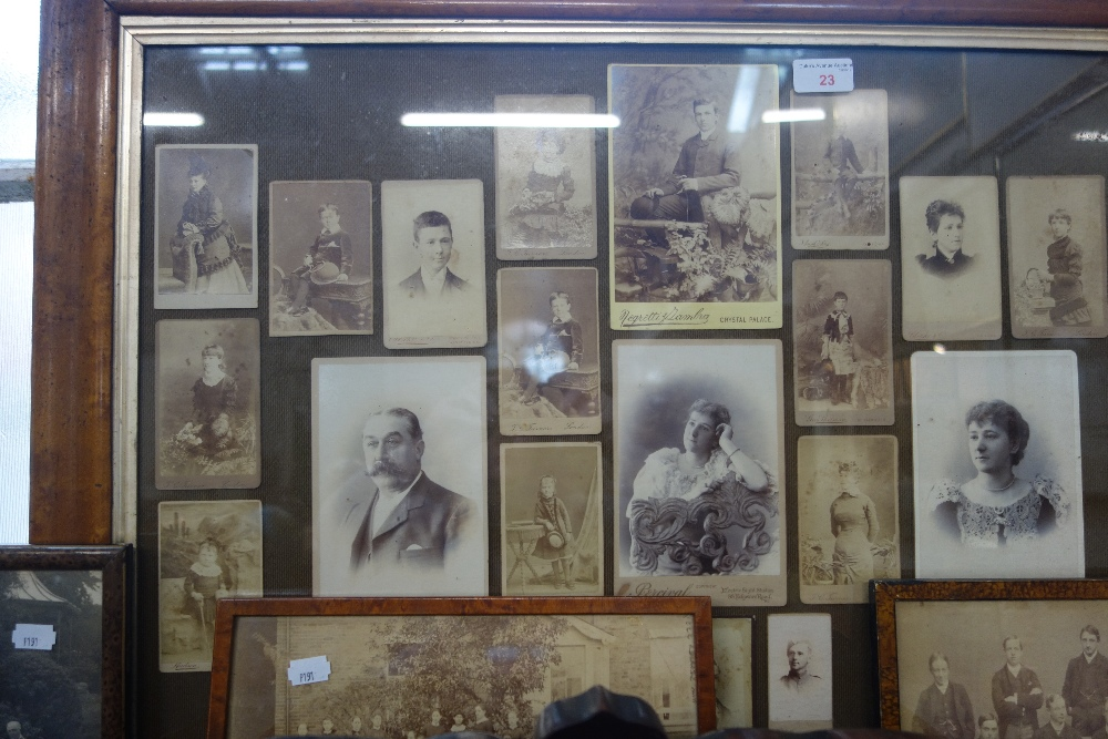 Lot 23 - A COLLECTION OF VICTORIAN CARTE DE VISITE AND CABINET PHOTOGRAPHS mounted in a maple frame and