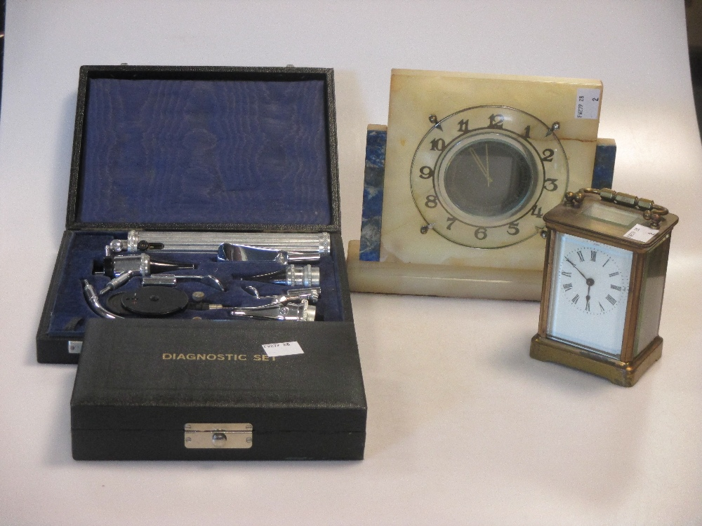 Lot 113 - An onyx mantel clock, carriage timepiece and two opthalmoscopes (one incomplete) (4)