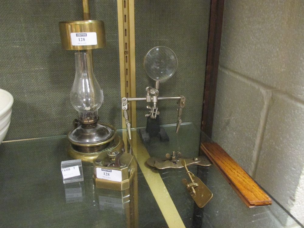 Lot 128 - A 19th century brass scarificator, a Swift microscope lamp, a magnifier and two brass early style