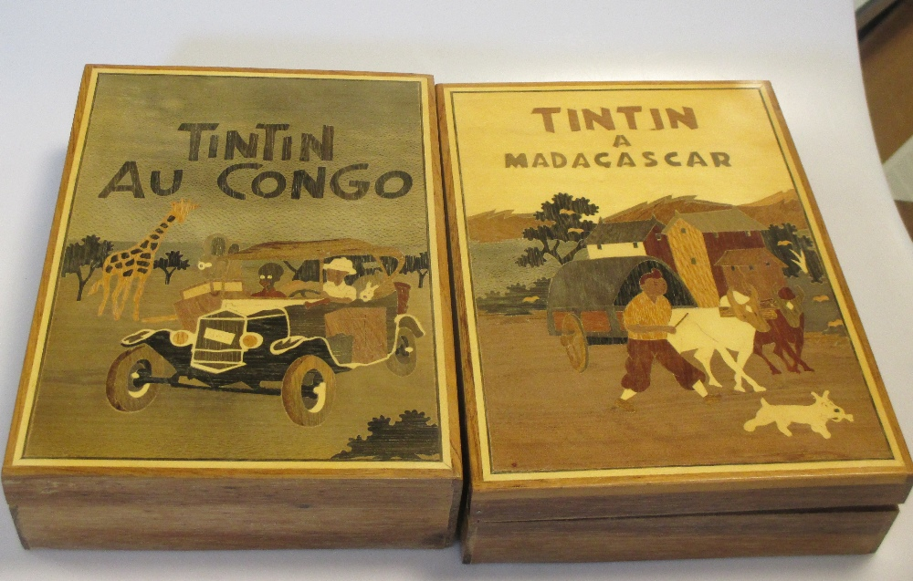 Lot 116 - Tin Tin a Madagascar and Tin Tin au Congo - two wooden illustrated wooden boxes (2)