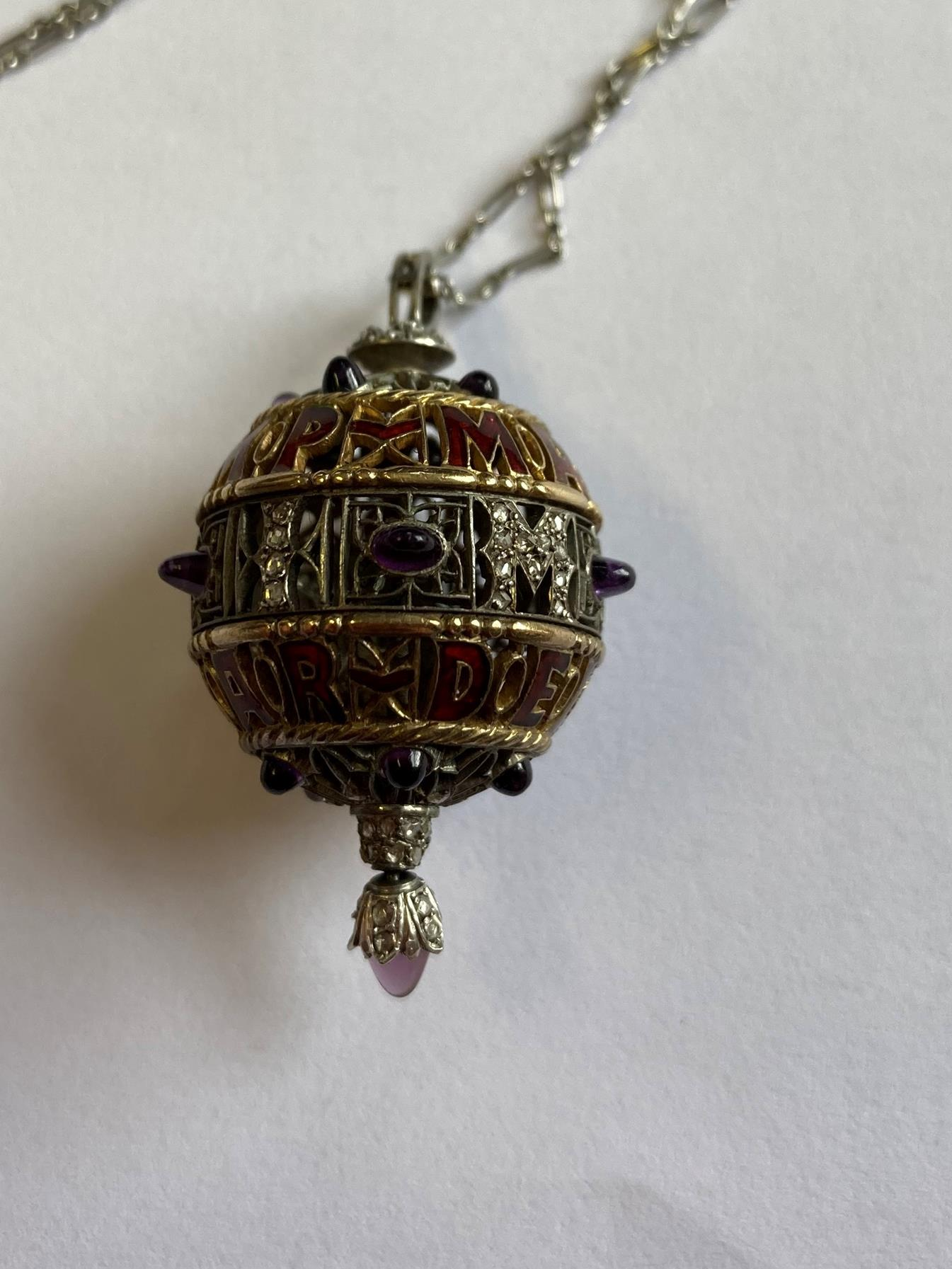 An Amethyst, Diamond and Enamel Pendant on Chain, 1911, the openwork ball with red enamel - Image 6 of 8