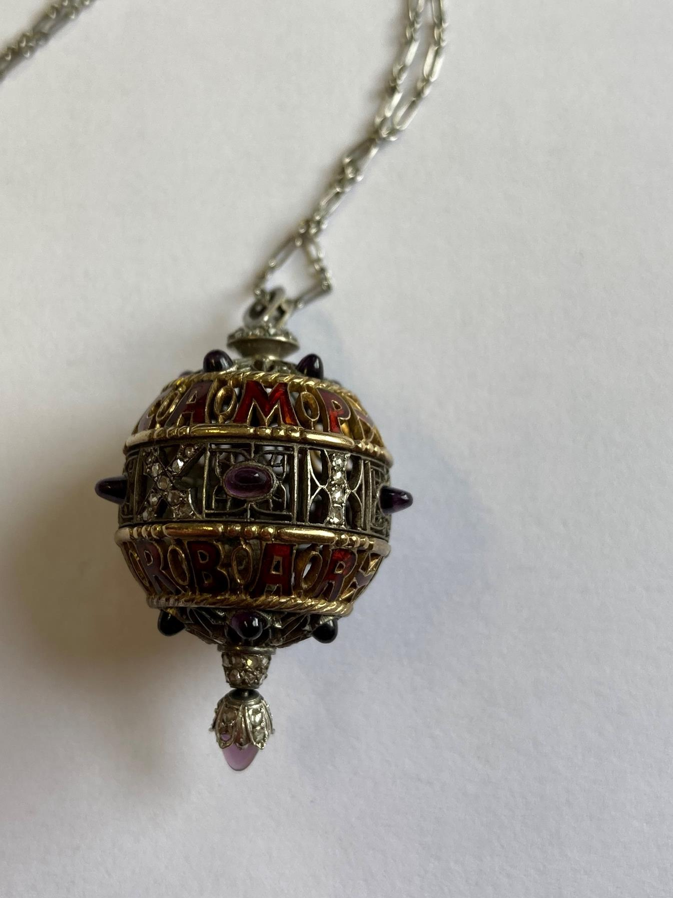 An Amethyst, Diamond and Enamel Pendant on Chain, 1911, the openwork ball with red enamel - Image 5 of 8