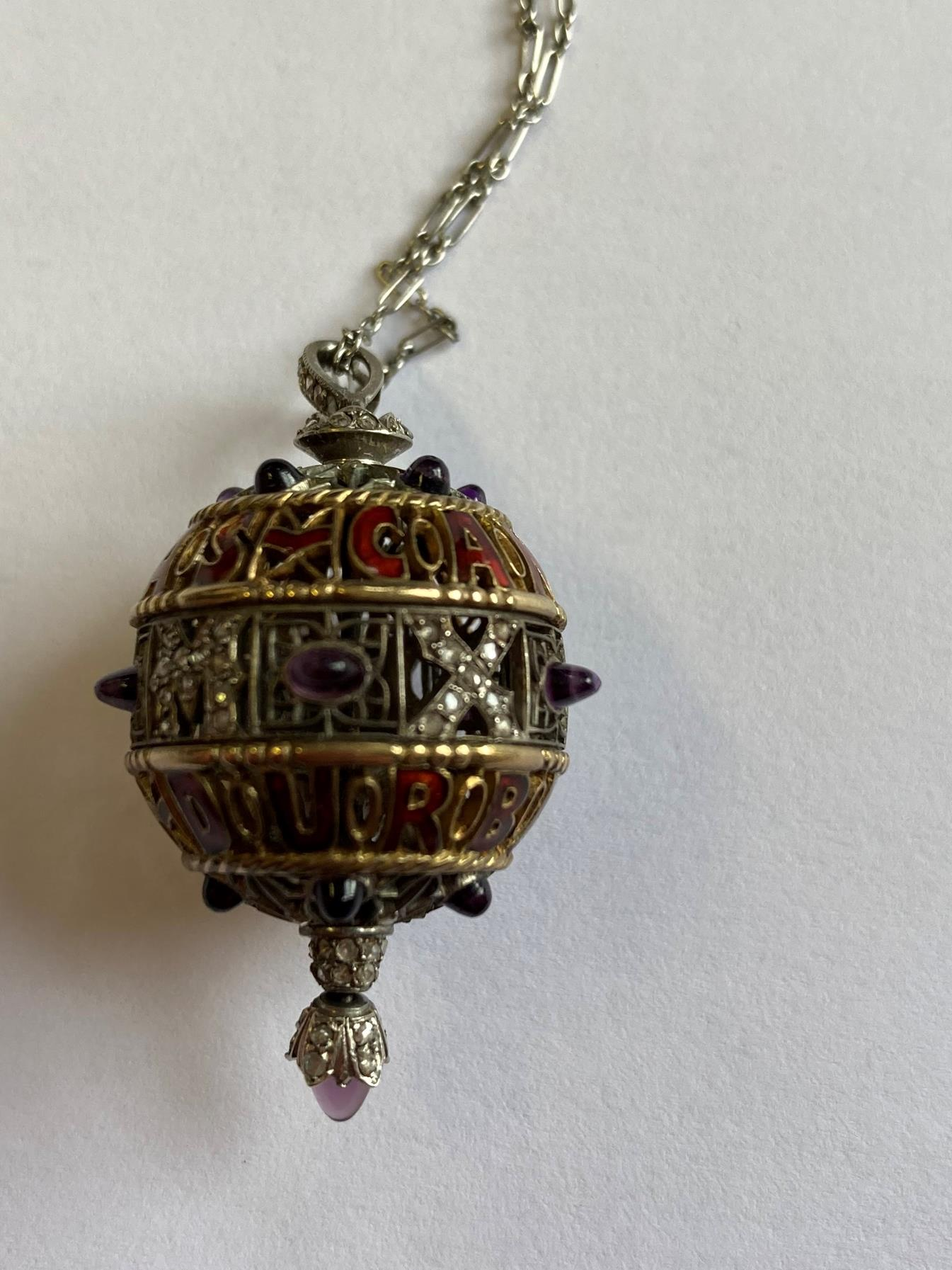 An Amethyst, Diamond and Enamel Pendant on Chain, 1911, the openwork ball with red enamel - Image 4 of 8