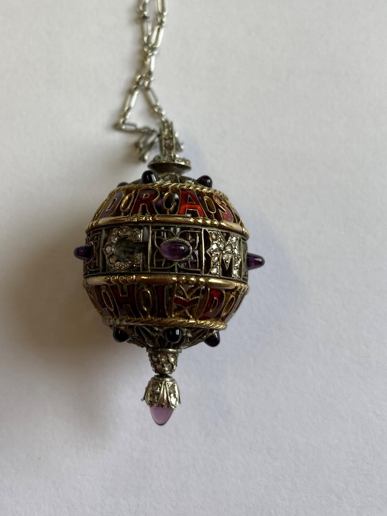 An Amethyst, Diamond and Enamel Pendant on Chain, 1911, the openwork ball with red enamel - Image 3 of 8