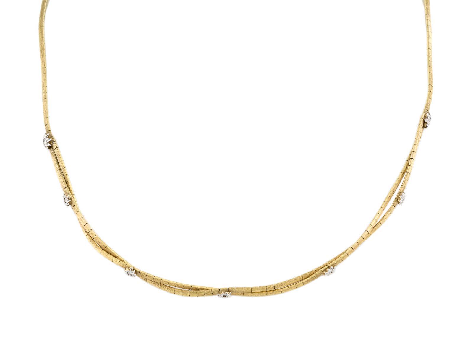 DIAMANT-COLLIER Gelbgold, Weißgold. L. 43,5 cm, Ges.-Gew. ca. 17,2 g. Gest. 585. Besetzt mit