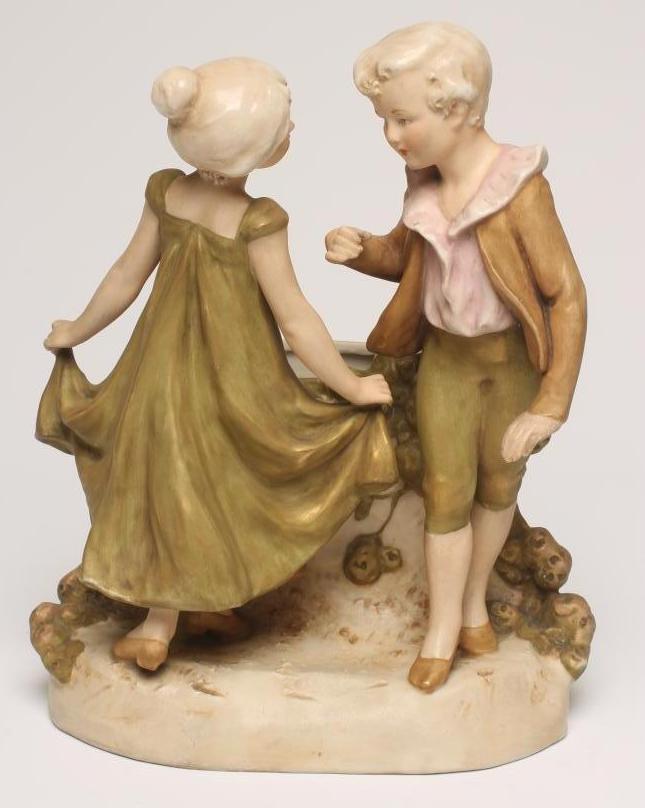 Lot 50 - AN ART NOUVEAU ROYAL DUX BISQUE PORCELAIN FIGURAL VASE, modelled as two children standing beside