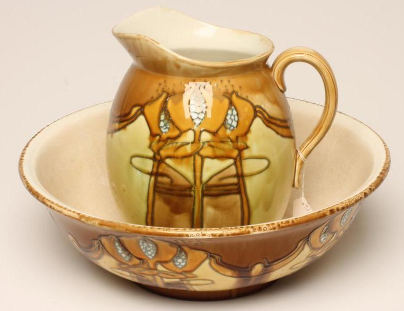 Lot 43 - A MINTONS SECCESSIONIST TOILET JUG AND BOWL, c.1905, tubelined and painted in shades of mustard