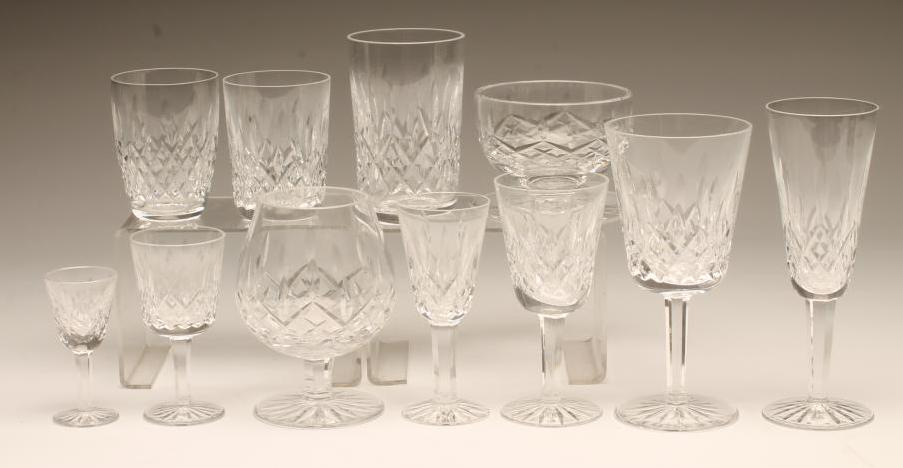 Lot 54 - A WATERFORD GLASS TABLE SUITE, modern, in Lismore pattern, comprising eight each hors d'ouevre