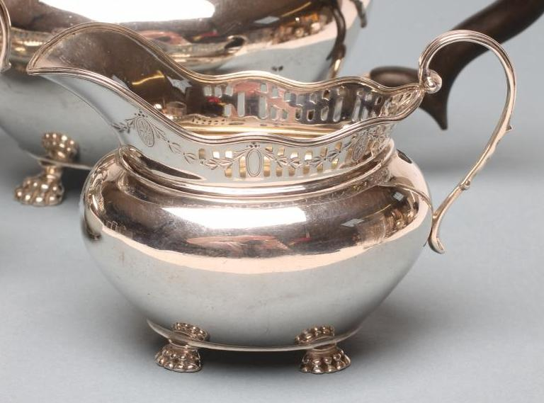 Lot 74 - A FOUR PIECE SILVER TEA AND COFFEE SERVICE, maker C C Pilling, Sheffield 1918, of oval form with