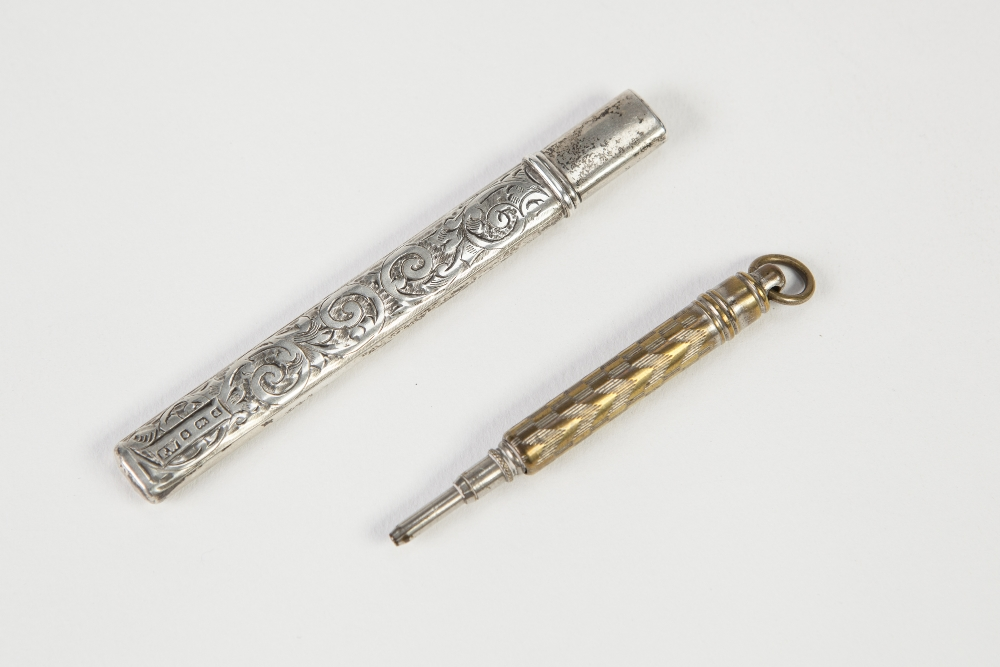 Lot 347 - EDWARD VII ENGRAVED SILVER SCISSORS CASE, of typical form with foliate scroll engraved decoration, 3