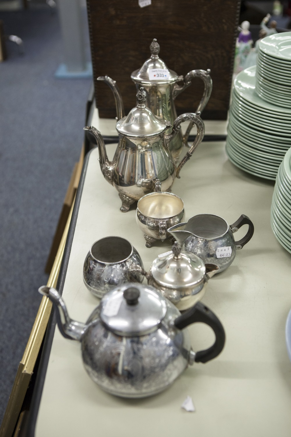 Lot 333 - A SILVER PLATE TEA/COFFEE SERVICE OF FOUR PIECES AND ANOTHER OF THREE PIECES
