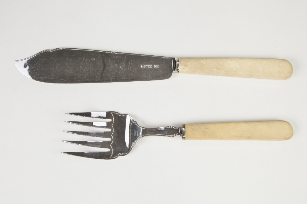 Lot 343 - PAIR GEORGE V PLAIN SILVER FISH SERVERS with ivorine handles, makers A & D Sheffield 1923, , 6 oz