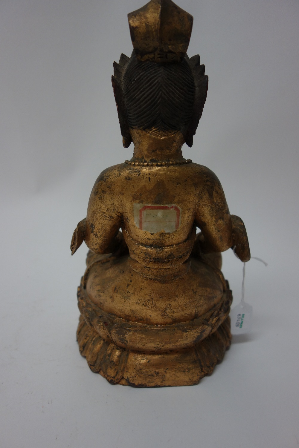 Lot 1378 - A Chinese giltwood figure of Buddha, late 19th/20th century,