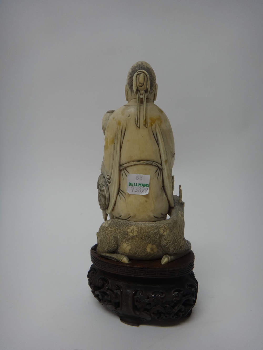 Lot 1410 - A Chinese ivory figure of Shoulao, early 20th century,
