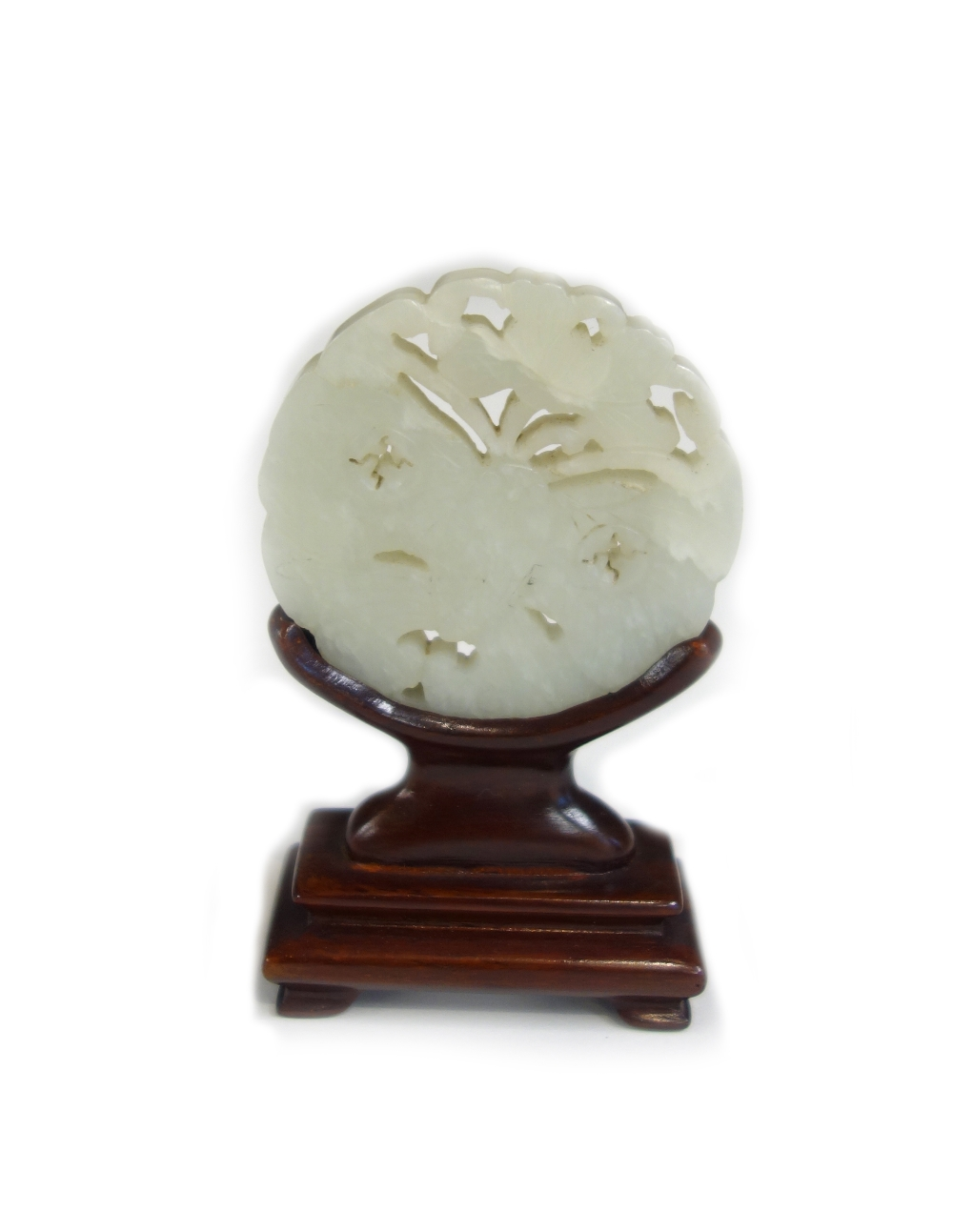 Lot 1436 - A Chinese pale celadon jade circular plaque, 20th century,
