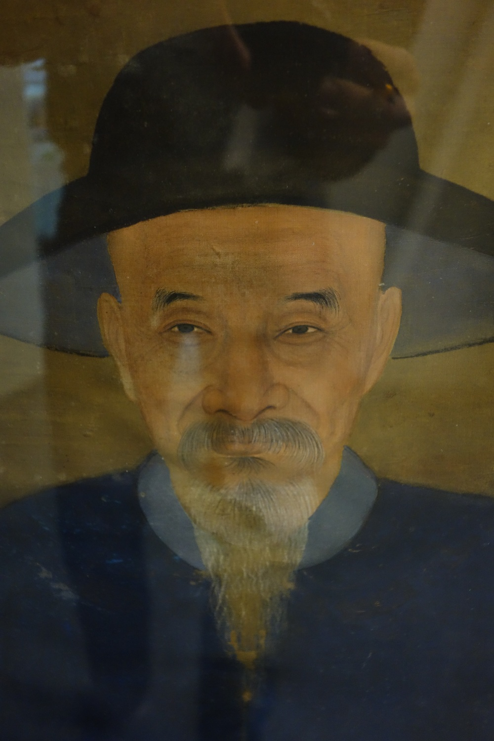 Lot 1321 - A Chinese ancestor portrait, 19th century, opaque pigment on silk,