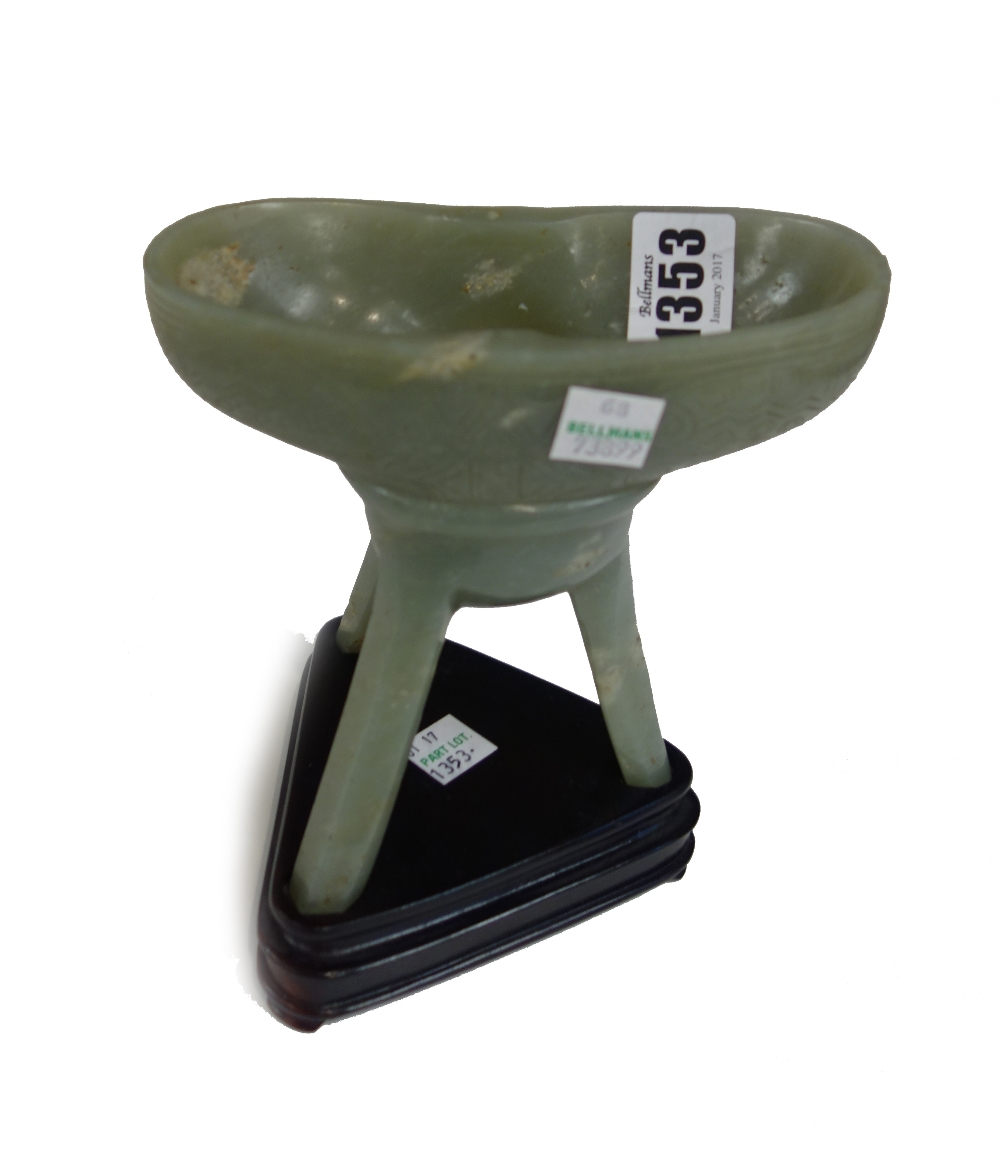 Lot 1353 - A Chinese jade tripod vessel (jue), incised Qianlong seal mark and probably of the period,