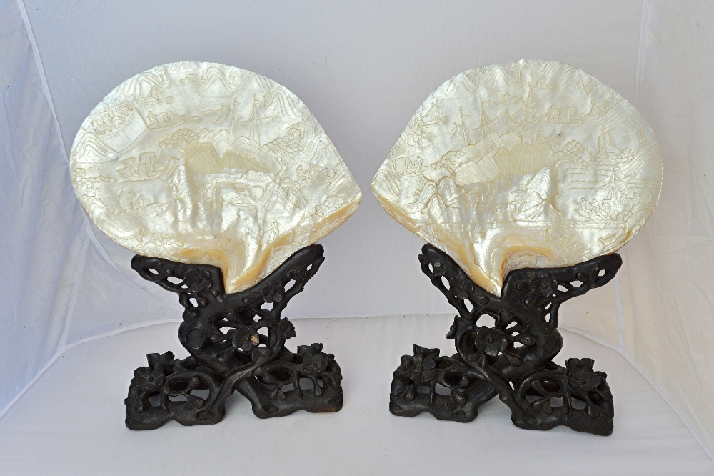 Lot 1384 - A pair of Chinese carved mother-of-pearl shells on stands, 19th century,