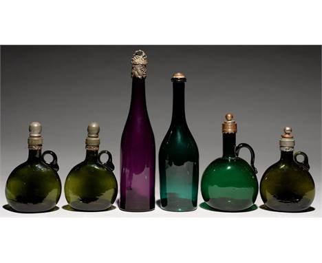 TWO NORTHERN EUROPEAN COLOURED GLASS DECANTERS, A FLAGON DECANTER, PROBABLY ENGLISH AND A SET OF THREE GERMAN SMALL GREEN BOC