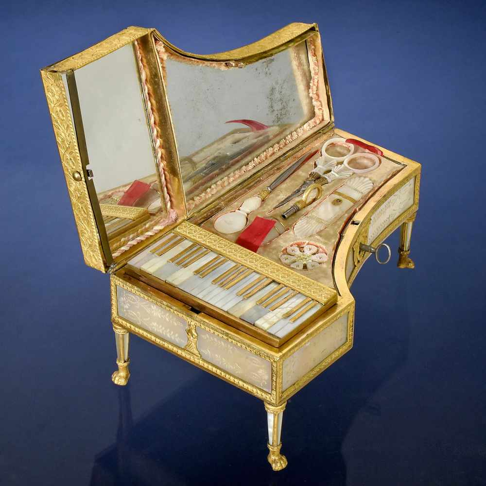 Lot 39 - Fine Palais Royale Musical Piano-Form Sewing Necessaire, c. 1830With two-air musical movement no.