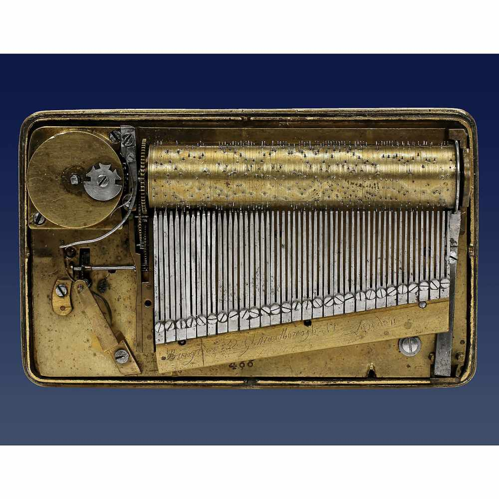 """Lot 13 - Rare Silver-Gilt Musical Snuff Box by Bruguier, c. 1818No. 466, the comb-base engraved """"Bruguier, 52"""