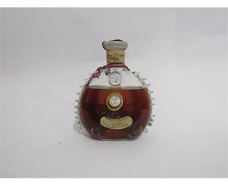 Remy Martin Louis XIII Cognac Tres Vieille, in Baccarat crystal decanter circa 1962-63, evaporation present, one glass nodule