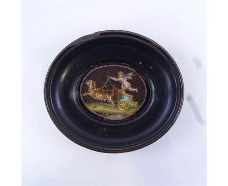 A fine quality Italian Grand Tour micromosaic miniature, depicting Eros driving a chariot, red glass backed, in ebonised wood