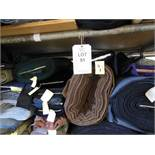 Large quantity of assorted fabrics including tweed, wool and cotton, in 3 bay steel keyway rack