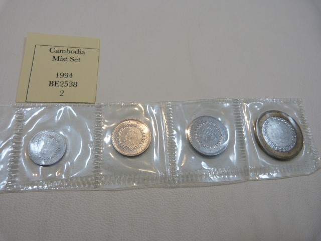 Lot 137 - A selection of Cambodian Coins from 1954 onwards to include 50 Centimes, Mint Set, 500 Riels, 200