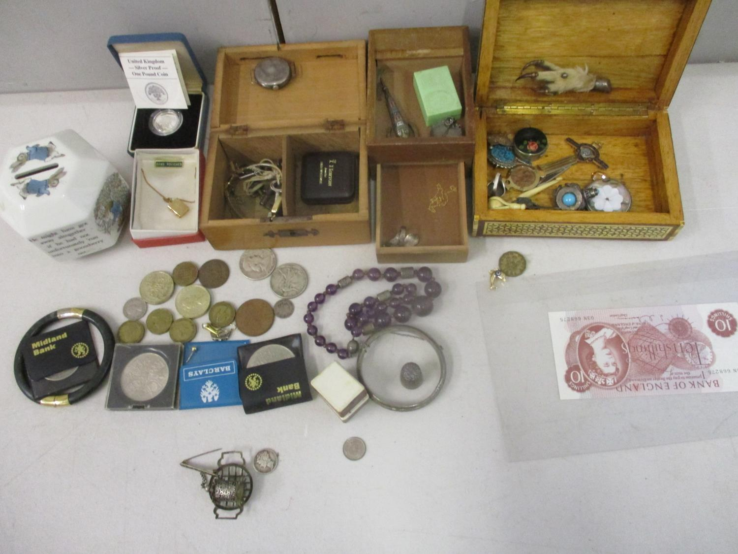 Collectables to include a silver cased wristwatch, coins, a ten shilling banknote, an enamelled