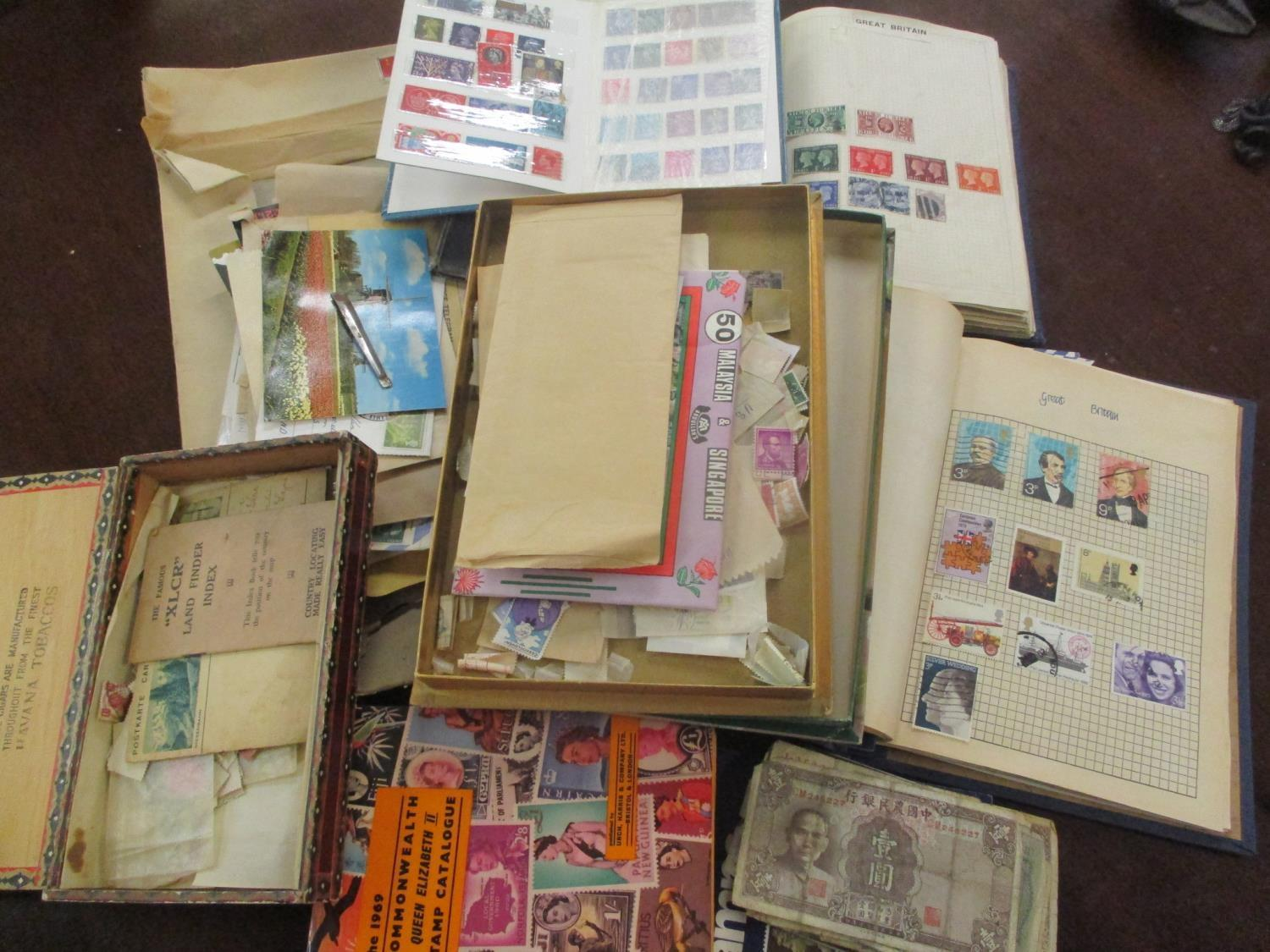 Mixed stamps from around the world mounted in albums and loose to include Victorian Penny Reds,