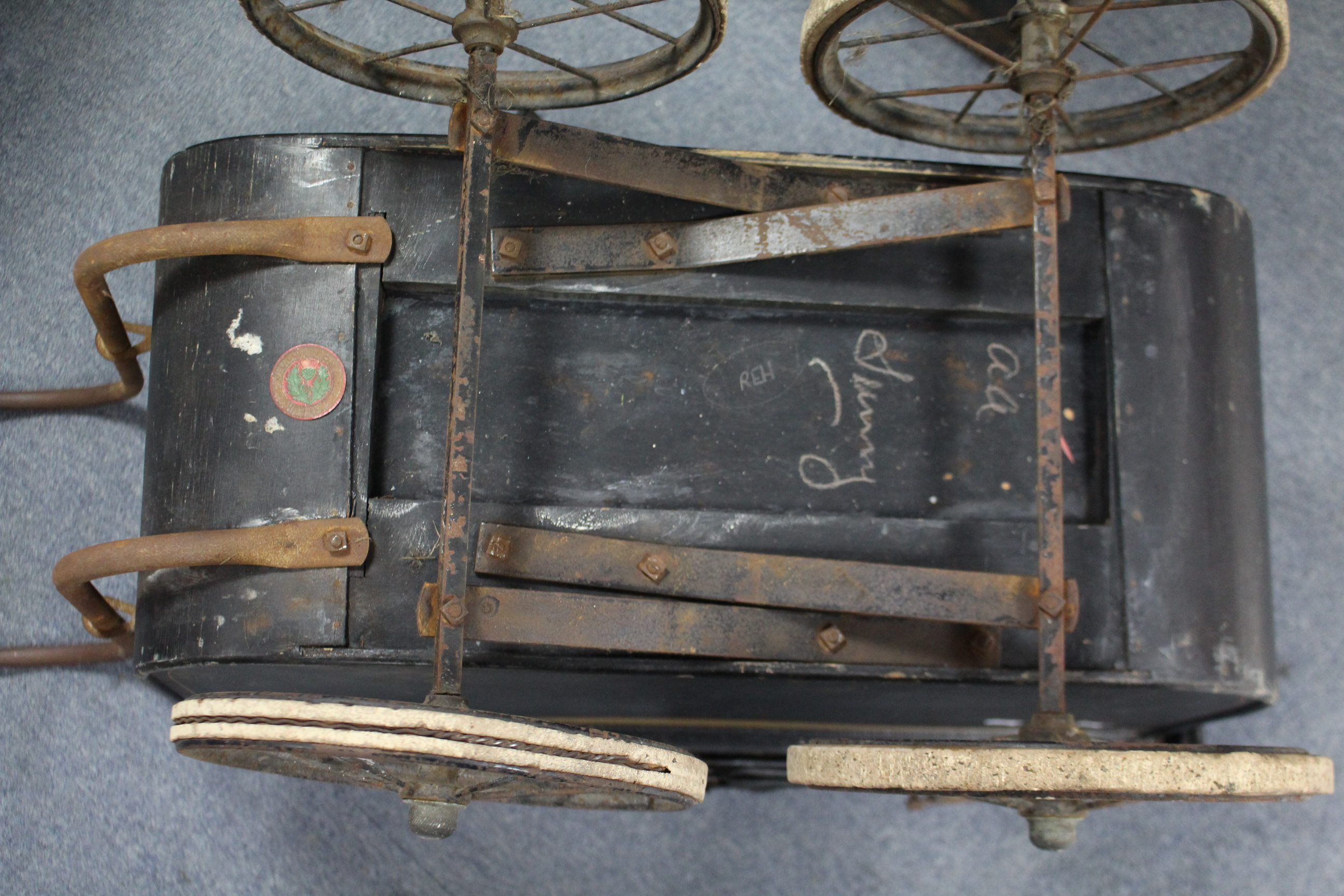 "Lot 48 - A Victorian coach-built pram (black) with 9"" diam. spoke wheels, 28"" long; together with an oil"